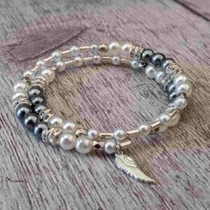 Pearl and grey wrap bracelet with angel wing charm
