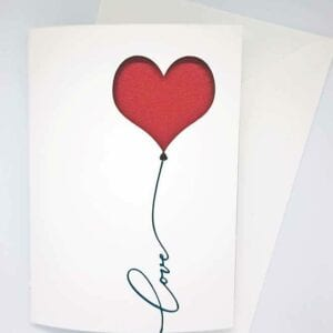 Valentine Papercut Card with 'love' sentiment.